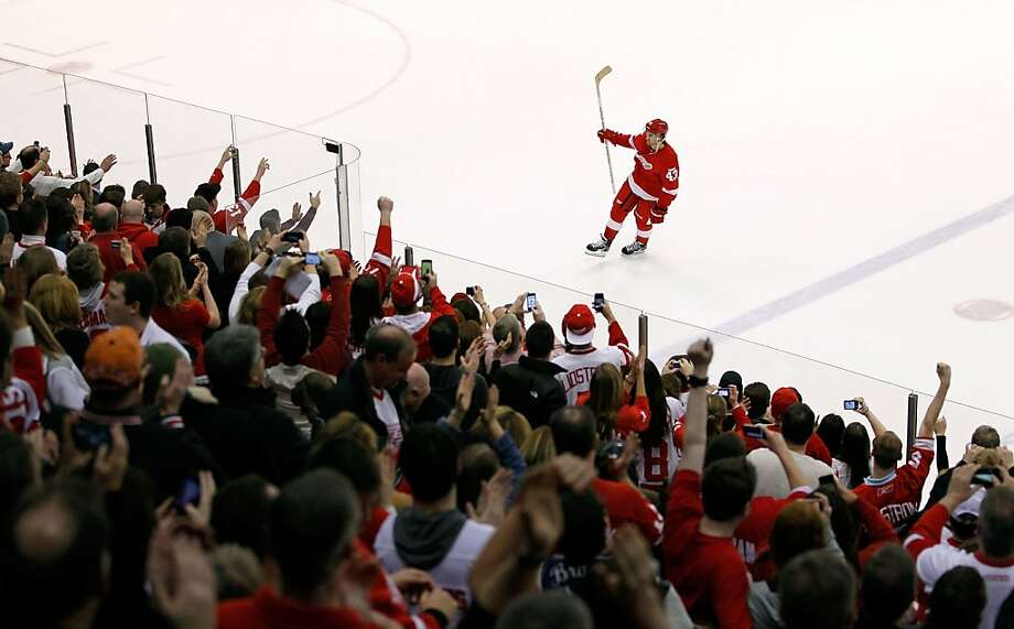 Darren Helm #43 of the Detroit Red Wings salutes fans as the second star of the game after the Red Wings NHL record breaking 21st consecutive home victory defeating the Dallas Stars 3-1 at Joe Louis Arena on February 14, 2012 in Detroit, Michigan. Photo: Gregory Shamus, Getty Images