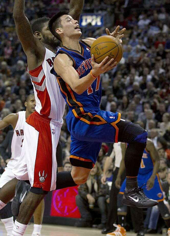 New York Knicks guard Jeremy Lin (17) drives against Toronto Raptors forward Amir Johnson during the first half of an NBA basketball game in Toronto on Tuesday, Feb. 14, 2012. Photo: Frank Gunn, Associated Press