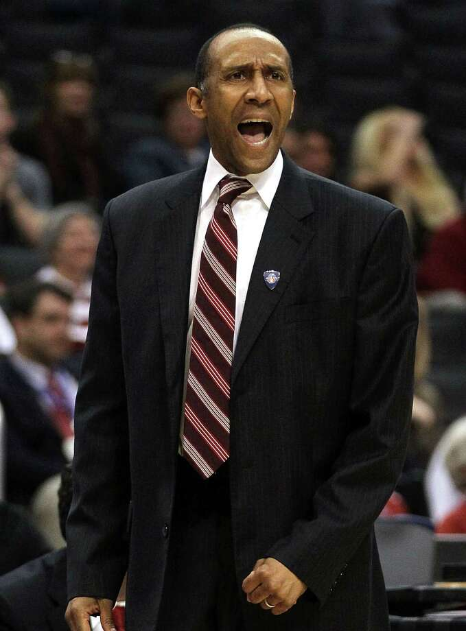 Head coach Johnny Dawkins of the Stanford Cardinal calls out in the first half while taking on Oregon State Beavers in the first round of the 2011 Pacific Life Pac-10 Men's Basketball Tournament at Staples Center on March 9, 2011 in Los Angeles, California. Photo: Jeff Gross / Getty Images / ONLINE_YES
