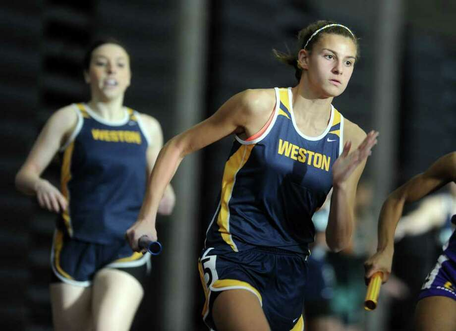 Weston's Whitney Farber runs the last leg of the 4x200 meter relay Tuesday, Feb. 14, 2012 during the State Class M track championship meet at the Floyd Little Athletic Center in New Haven, Conn. Photo: Autumn Driscoll / Connecticut Post