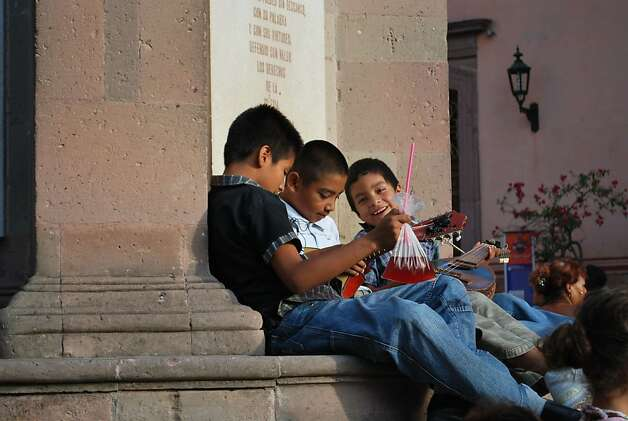 Children play outside a church. San Miguel's faithfully restored colonial-era churches, convents and mansions are among Mexico's most beautiful. Photo: Maribeth Mellin, Special To SFGate