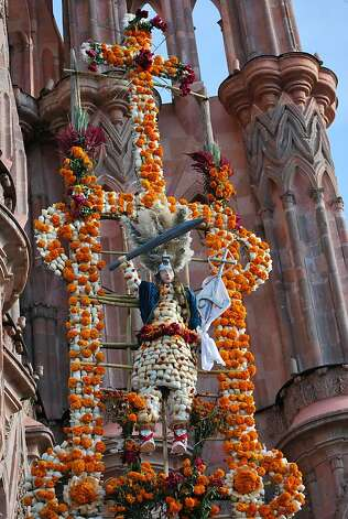 Xuchiles made of white agave, gold marigolds and cactus bulbs placed in front of the Parroquia. Photo: Maribeth Mellin, Special To SFGate