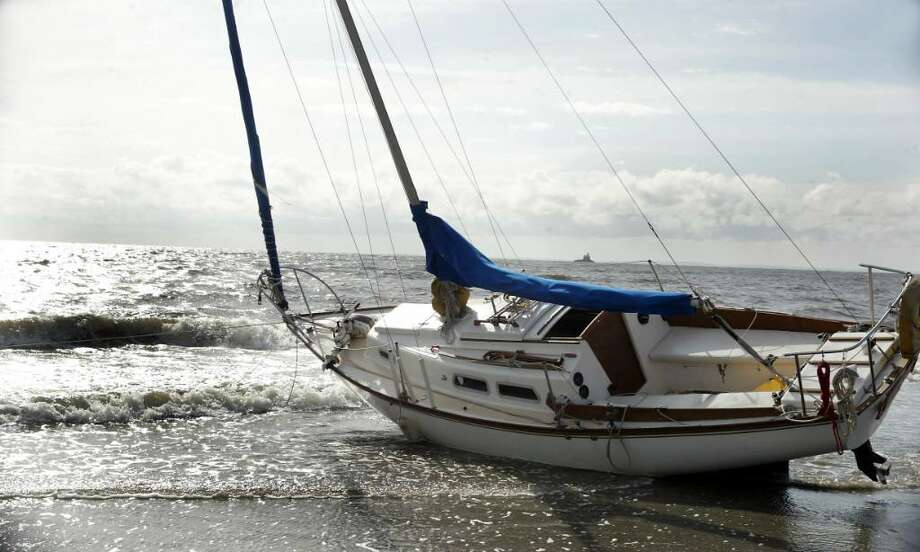 """The 20' sailboat, """"Jenny"""", is grounded on Penfield Beach in Fairfield, Thursday morning, Sept. 10, 2009. The sailboat ran aground Wednesday night, Sept. 9 2009. Photo: Phil Noel / Connecticut Post"""