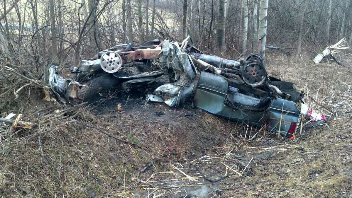 The remnants of a car that rolled over and caught fire Wednesday morning on Route 146 in Knox near the Schoharie County line. The driver died in the accident. (Albany County Sheriff's Office)