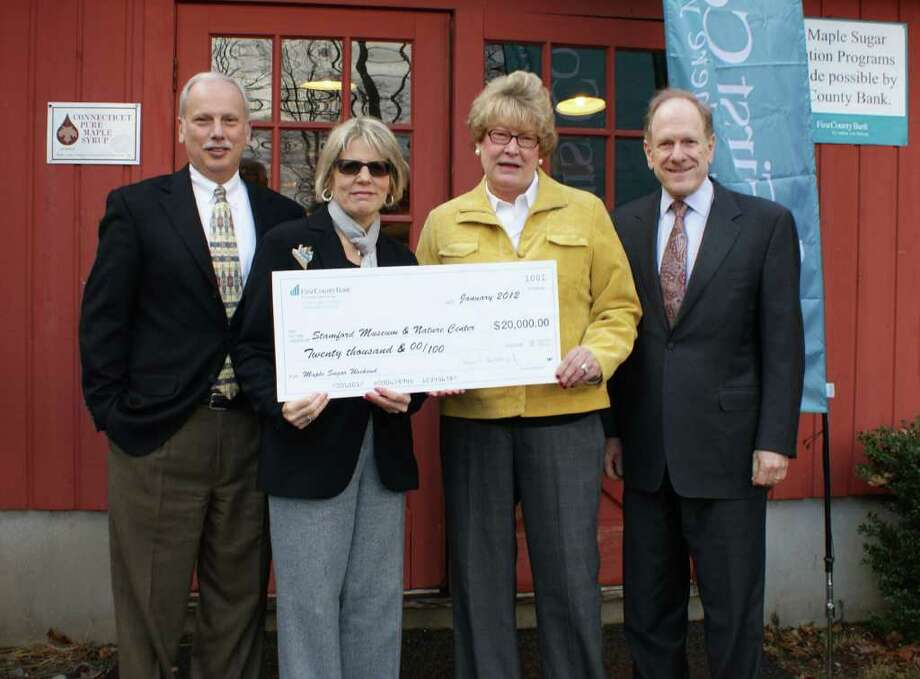 Rey Giallongo, chairman and CEO of First County Bank; Karen Kelly, senior vice president and chief marketing officer of First County Bank; Melissa H. Mulrooney, executive director of Stamford Museum & Nature Center; and David A. Swerdloff, president of the Stamford Museum & Nature Centerís board of directors. Photo: Contributed Photo