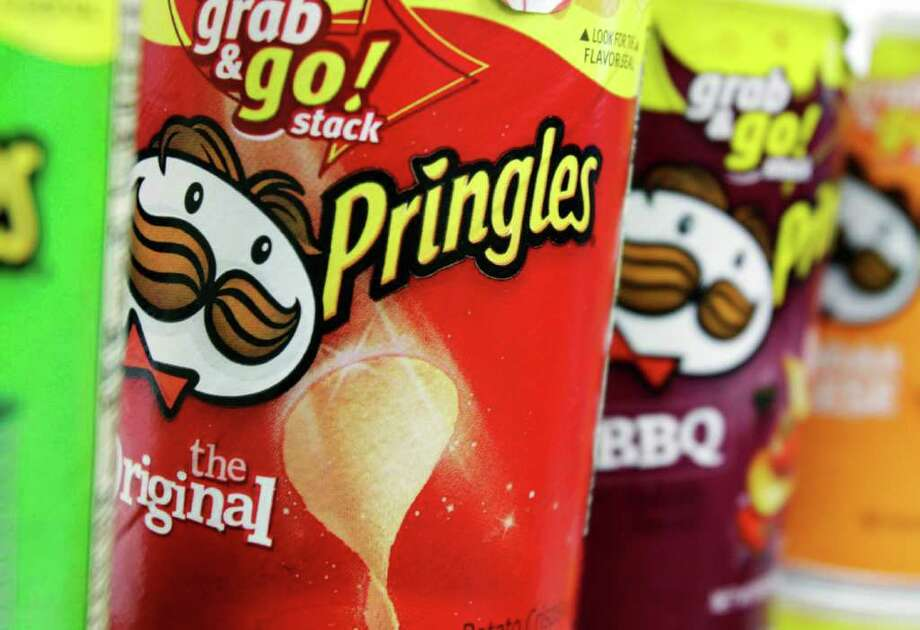 FILE - In this April 5, 2011 file photo, Pringles chips are seen in a posed photo at a West Bath grocery store. Kellogg Company announced Wednesday, Feb. 15, 2012, that it has entered into an agreement to acquire Procter & Gamble's Pringles business for $2.695 billion. (AP Photo/Pat Wellenbach, File) Photo: Pat Wellenbach / AP2011