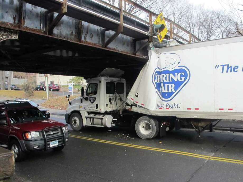 A tractor trailer crashed into the West Street Bridge on Wednesday, Feb. 15, 2012. Photo: Libor Jany