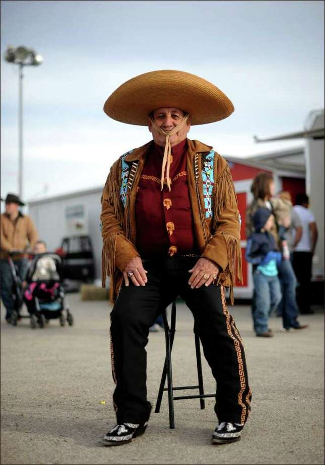 "Jose ""Jumping Joe"" Rodriguez wears charro attire at the San Antonio Stock Show. ""I broke the world record of parachute jumps in 1974. I was testing chutes for NASA,"" he said. Cowboys and cowgirls display their buckles and bling on Feb. 11, 2012.  Photo: Billy Calzada, San Antonio Express-News / San Antonio Express-News"