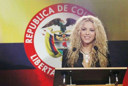 Colombian pop star Shakira speaks at a press conference at the Narino Palace in Bogota, Colombia, Tuesday, March 11, 2003. Some 50,000 people are expected to attend Shakira's concert Wednesday night, her first in her homeland in three years.(AP Photo/HO/ Fernando Ruiz,CNE) (FERNANDO RUIZ / AP)