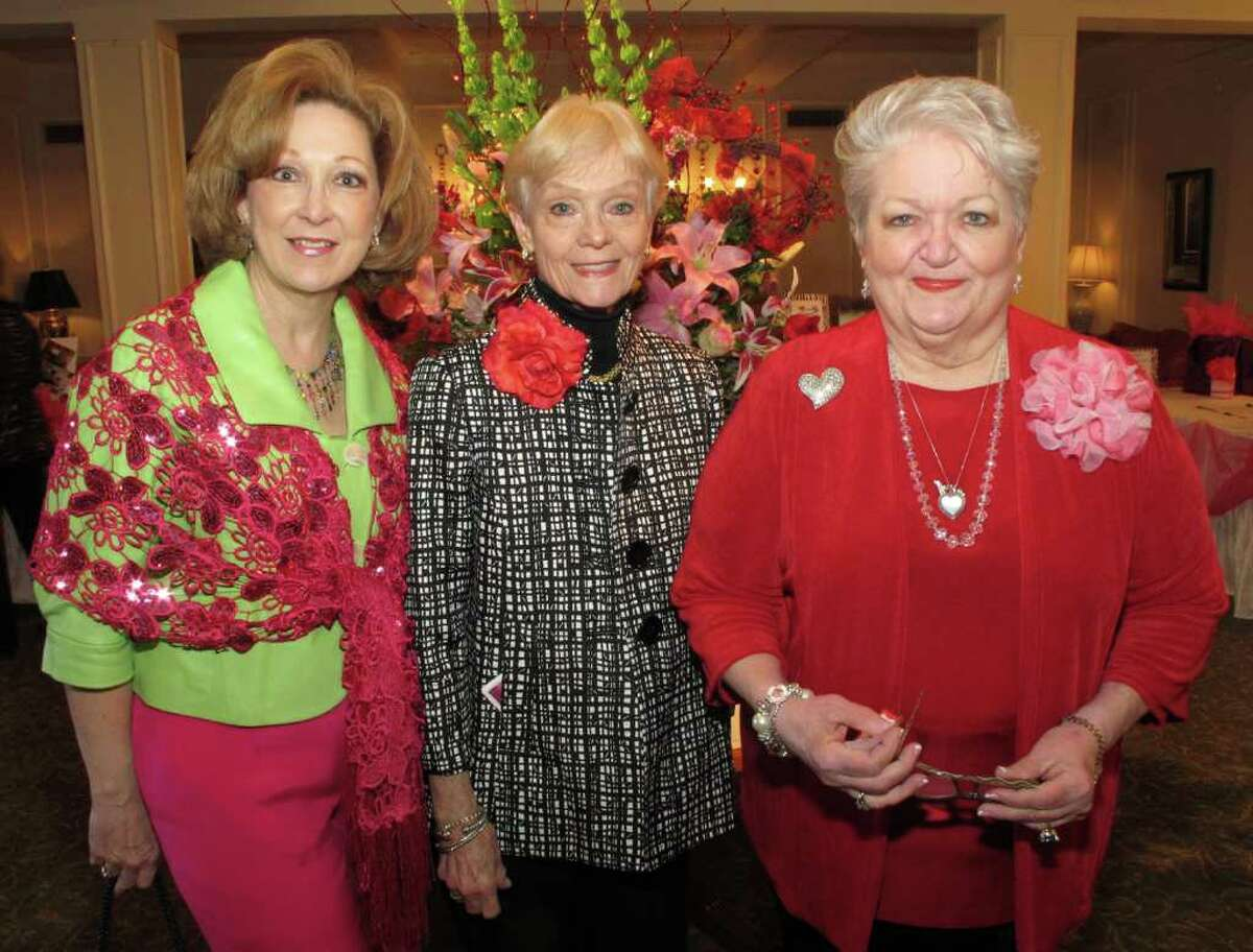 Stager Sara Kliewer (from left), auction co-chairwoman Johanna Comuzzi and event co-chairwoman Patti King gather during the Friends of Hospice Valentine style show and luncheon at the San Antonio Country Club.