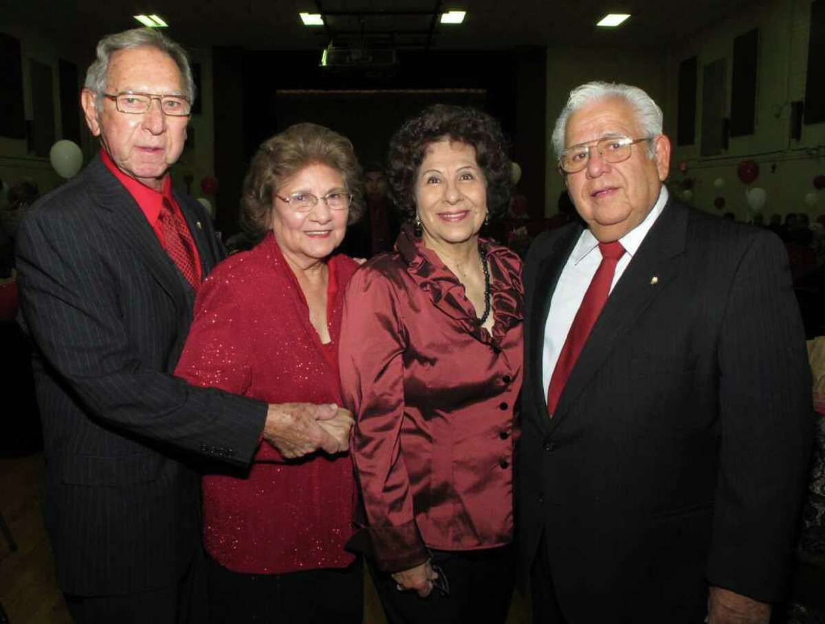 Committee members Fred and Helen Garcia (from left) join committee members Connie and Marcos Villalon during the Knights of Columbus No. 6833 Valentine Dance at Little Flower Parish Hall.