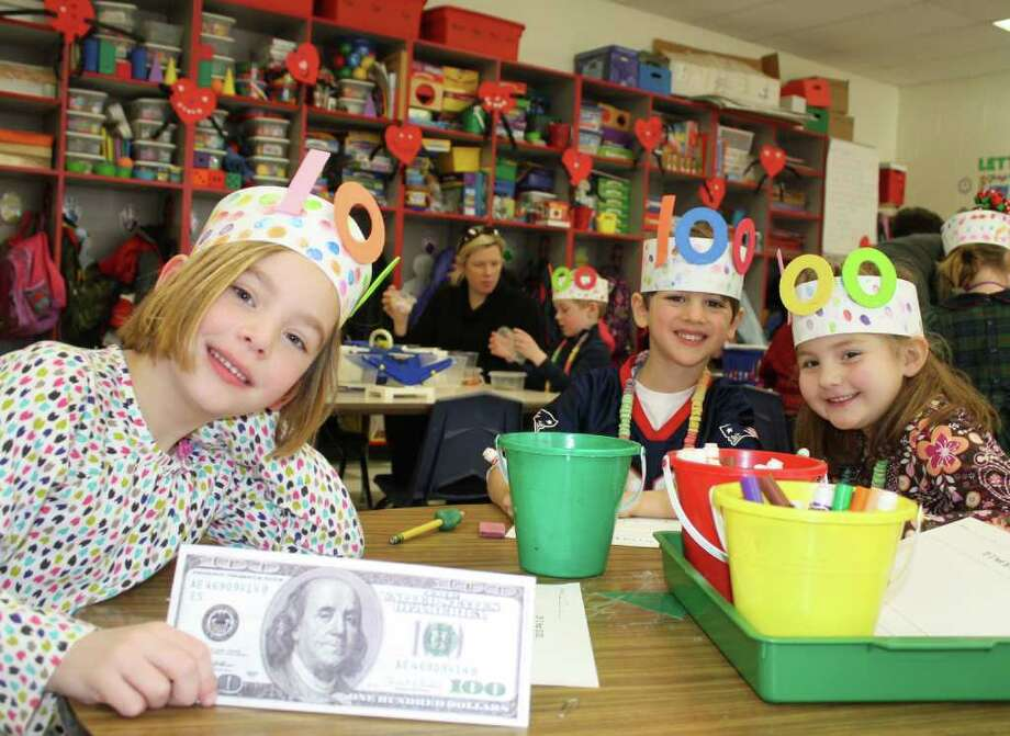 Holmes School kindergarteners celebrate 100 Days of School. From left, Cailin Zielinski, Morgan Brown and Kathryn Reynolds. Photo: Contributed Photo