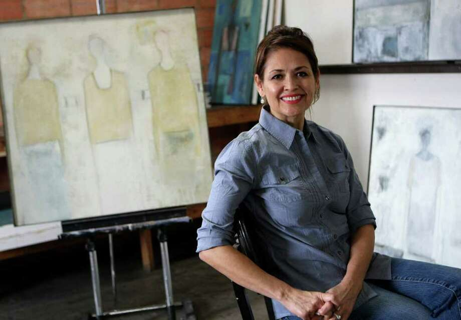 Laura Mijangos is the daughter of the late Alberto Mijangos, a respected abstract artist. She is having an exhibit of her own work at Anarte Gallery.  Helen L. Montoya/San Antonio Express-News Photo: HELEN L. MONTOYA, San Antonio Express-News / ©SAN ANTONIO EXPRESS-NEWS
