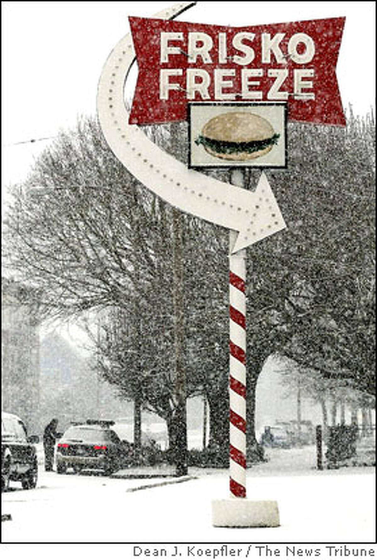 Cold and snow sent Tacoma, Wash., and the south sound into a freeze, including the iconic drive-in Frisko Freeze on Monday, March 9, 2009. (AP Photo/The News Tribune, Dean J. Koepfler )