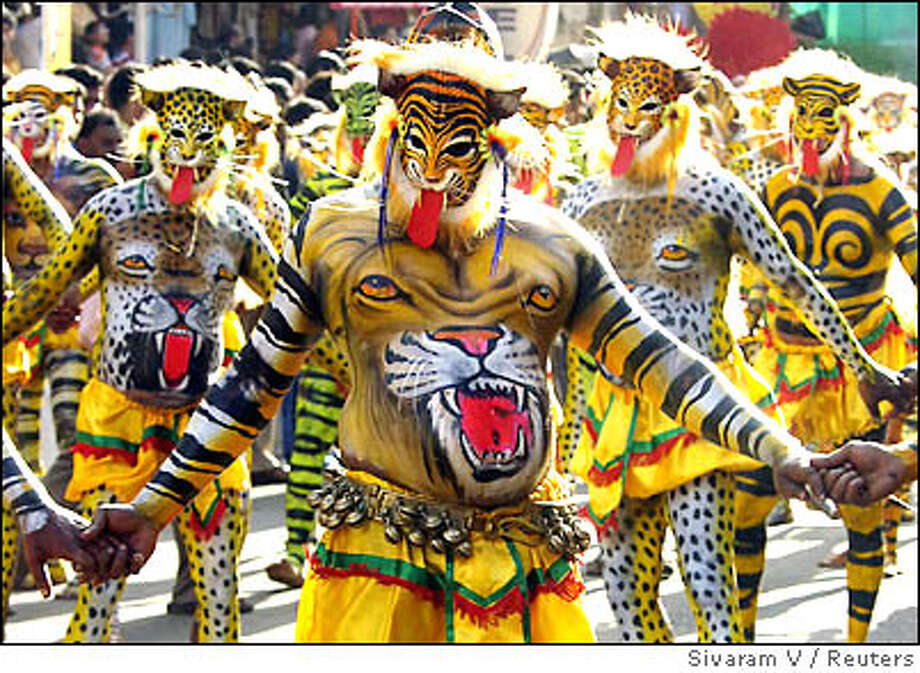 Performers dressed as tigers take part in Pulikali, or tiger dance, during festivities in Trichur city, in the southern Indian state of Kerala Photo: STRINGER/INDIA