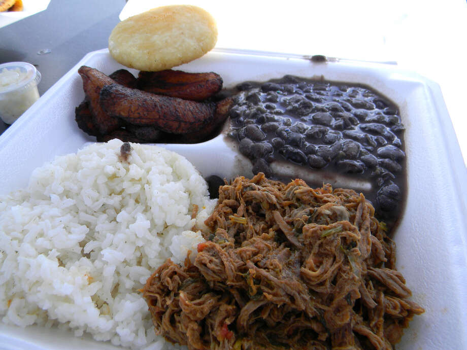 Mireya Montilla McDonald owns El Punto Criollo trailer, where she serves Venezuelan fare such as cachapa (a corn fritter filled with queso fresco) and Pabellon Criollo (shredded beef with rice, beans and fried plantains). Photo: Paul Galvani