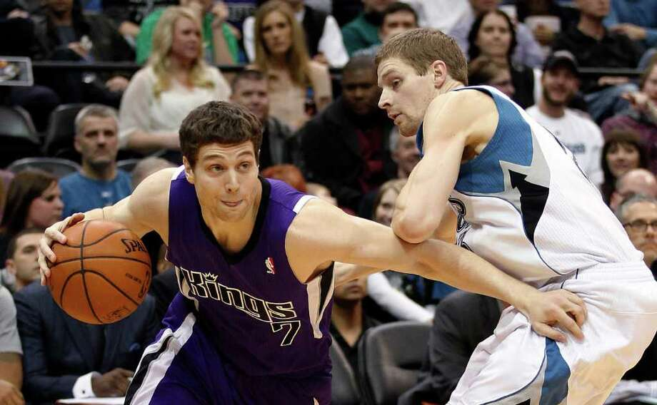 Sacramento Kings guard Jimmer Fredette, left, drives on Minnesota Timberwolves guard Luke Ridnour in the second quarter of an NBA basketball game Tuesday, Feb. 7, 2012, in Minneapolis. The Timberwolves won 86-84. Photo: Andy King, AP / FR51399 AP