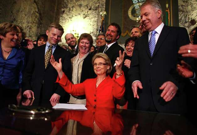Gov. Gregoire signs marriage equality legislation last February, flanked by sponsors Rep. Jaime Pedersen (l) and State Sen. Ed Murray (r).  Washington is voting on Referendum 74, which would ratify the decision of legislators and the governor. / SEATTLEPI.COM
