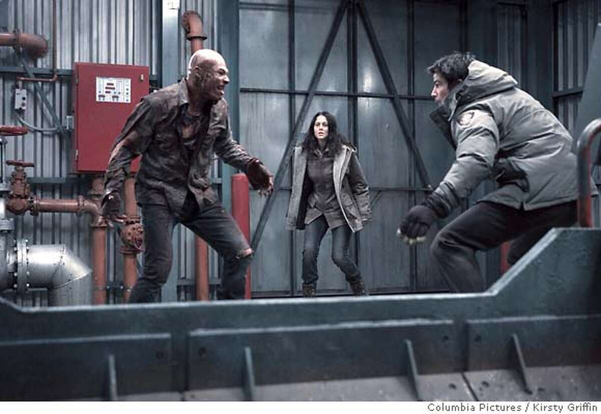 PK-20 Arvin (Andrew Stehlin, left), a vampire, takes on Denise (Amber Sainsbury, center) and town sheriff Eben Oleson (John Hartnett, right) in the isolated town of Barrow, Alaska in Columbia Pictures� .