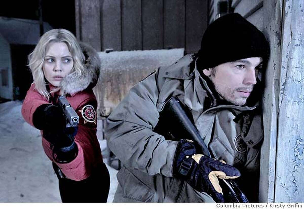 This photo provided by Sony Pictures shows Josh Hartnett, right, and Melissa George in