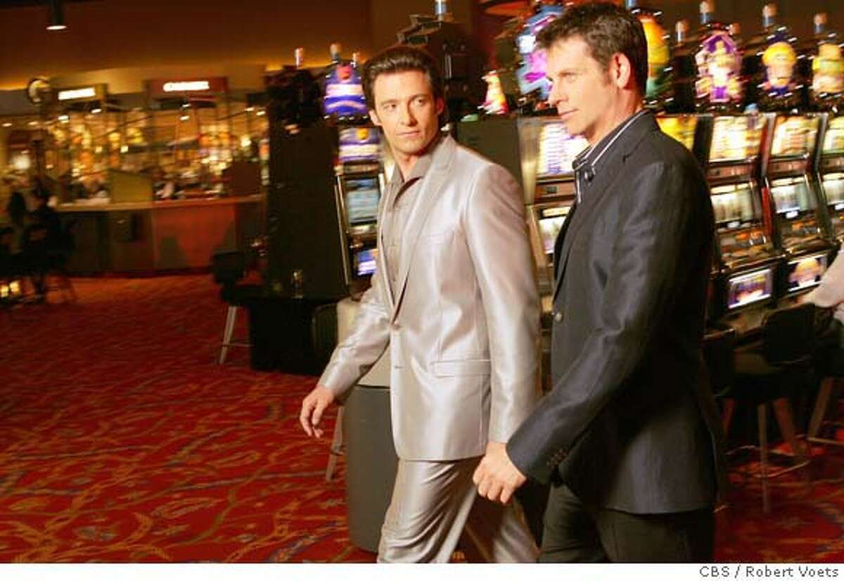 """""""Pilot"""" -- Ripley (Lloyd Owen, right) and Nicky (Hugh Jackman) discuss the casino business on, VIVA LAUGHLIN which will premiere on a special night, Thursday, Oct. 18 (10:00-11:00 PM ET/PT) on the CBS Television Network. Photo: Robert Voets/CBS �2007 CBS Broadcasting Inc. All Rights Reserved."""