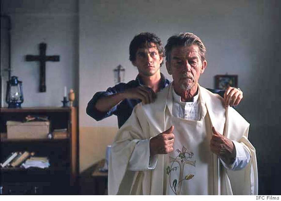 John Hurt (�Father Christopher�) in a scene from BEYOND THE GATES directed by Michael Caton-Jones. An IFC Films release. Photo: Ho