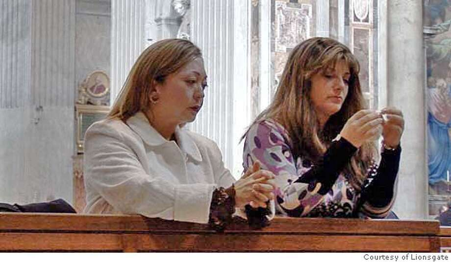 2. Survivors Ann Jyono (left) and Nancy Sloan (right) pray in St. Peter's Basilica, Rome. Photo courtesy of Lionsgate