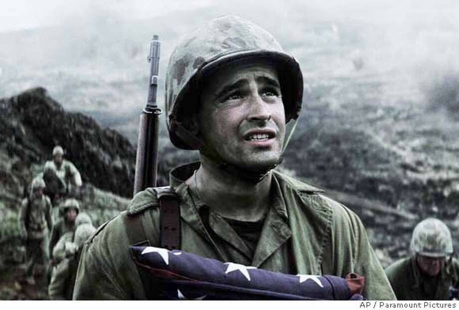 "This undated publicity photo released by Paramount Pictures, shows actor Jesse Bradford in this scene from the new film, ""Flags Of Our Fathers."" (AP Photo/Paramount Pictures) PHOTO PROVIDED BY PARAMOUNT PICTURES, , PHOTOGRAPHS TO BE USED SOLELY FOR ADVERTISING, PROMOTION, PUBLICITY OR REVIEWS OF THIS SPECIFIC MOTION PICTURE AND TO REMAIN THE PROPERTY OF THE STUDIO. NOT FOR SALE OR REDISTRIBUTION. Photo: Ho"