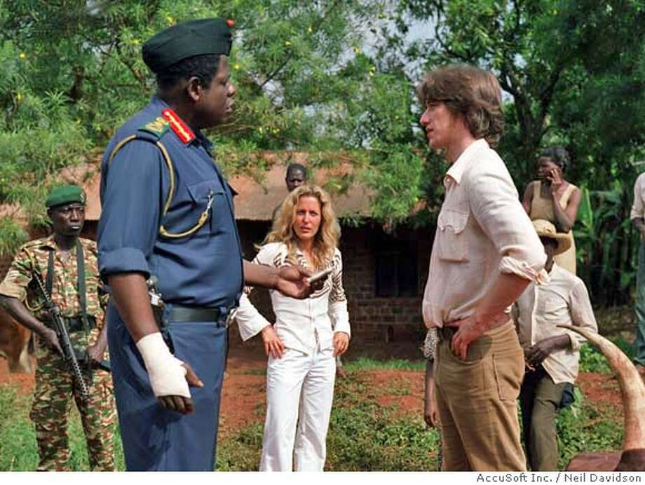 "Forest Whitaker (from left) as Idi Amin, Gillian Anderson and James McAvoy in ""The Last King of Scotland."" Photo by Neil Davidson"
