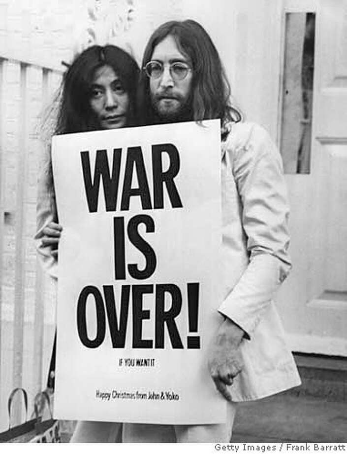 John Lennon (1940 - 1980) and Yoko Ono pose on the steps of the Apple building in London, holding one of the posters that they distributed to the world's major cities as part of a peace campaign protesting against the Vietnam War. 'War Is Over, If You Want It'. (Photo by Frank Barratt/Getty Images)Yoko Ono and John Lennon holding 'War Is Over' poster, in an image featured in THE U.S. VS. JOHN LENNON. Photo courtesy GETTY IMAGES (credit must be given to the source). Photo: Frank Barratt