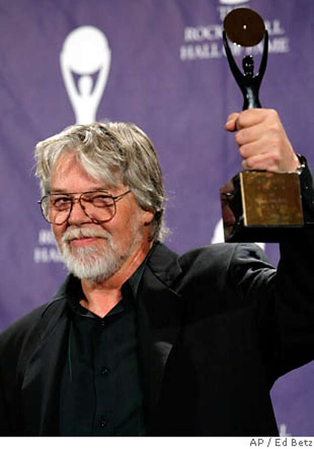 Bob Seger being inducted into the Rock and Roll Hall of Fame in 2004. Associated Press file photo by Ed Betz