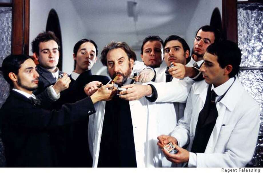 "Juanjo Puigcorb� (center) as Dr. Mira in Joaquin Oristrell's Spanish sex comedy ""Unconscious,"" opening Friday. Credit: Regent Releasing  Ran on: 12-29-2006  Juanjo Puigcorbe (center) plays Dr. Mira in &quo;Unconscious,&quo; a Spanish comedy set in 1913 Barcelona. Photo: Regent Releasing"