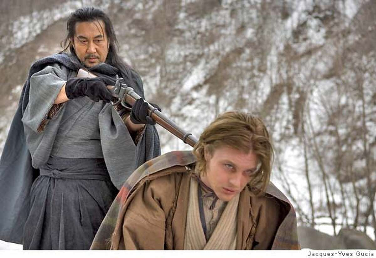Hara Jubei (Koji Yakusho, left) plays a local baron with whom French silkworm merchant Herve Joncour (Michael Pitt) becomes involved during his travels in Japan in Franois Girard's