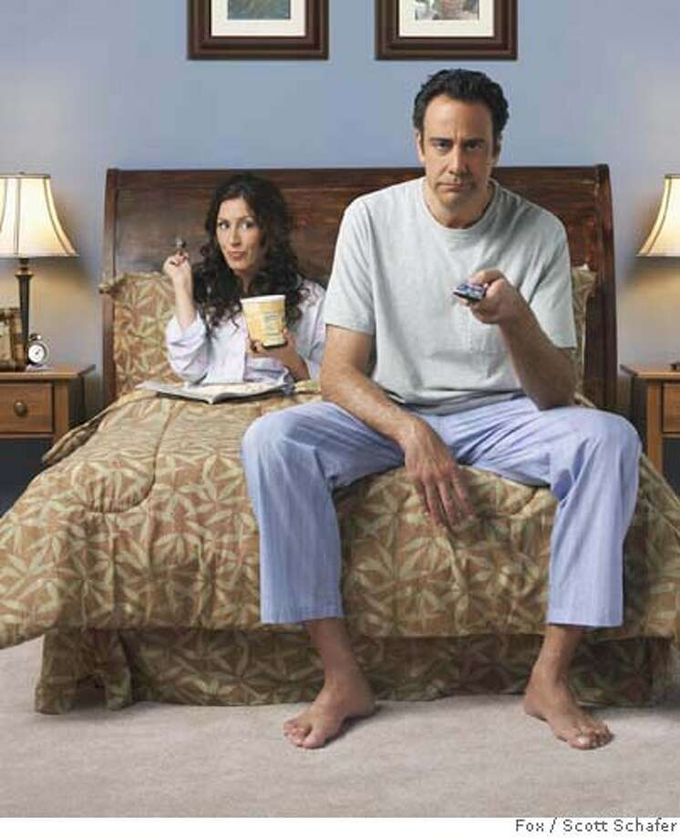 'TIL DEATH: Brad Garrett and Joely Fisher in 'TIL DEATH premiering Thursday, Sept. 7 (8:00-8:30 PM ET/PT) on FOX. �2006 Fox Broadcasting Co. Cr: Scott Schafer/FOX Photo: Capture