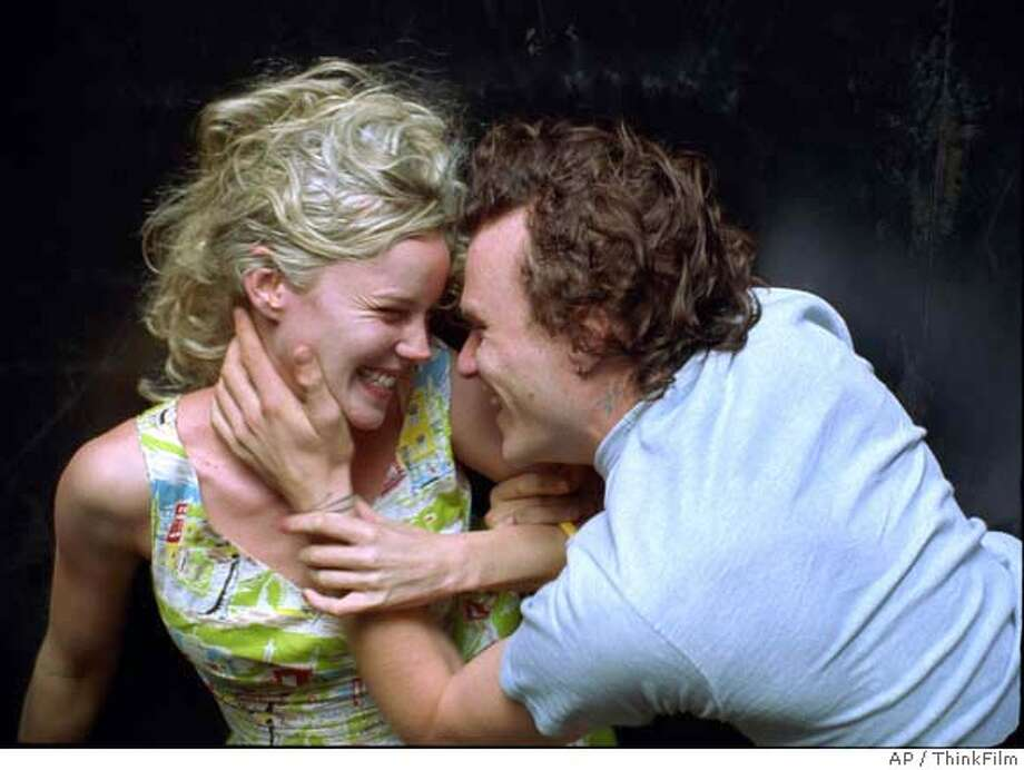"In this photo provided by ThinkFilm, Dan, a poet (Heath Ledger) falls in love with an art student Candy (Abbie Cornish) who gravitates to his bohemian lifestyle -- and his love of heroin in ""Candy."" (AP Photo/ThinkFilm) Photo: AP Photo/ThinkFilm"