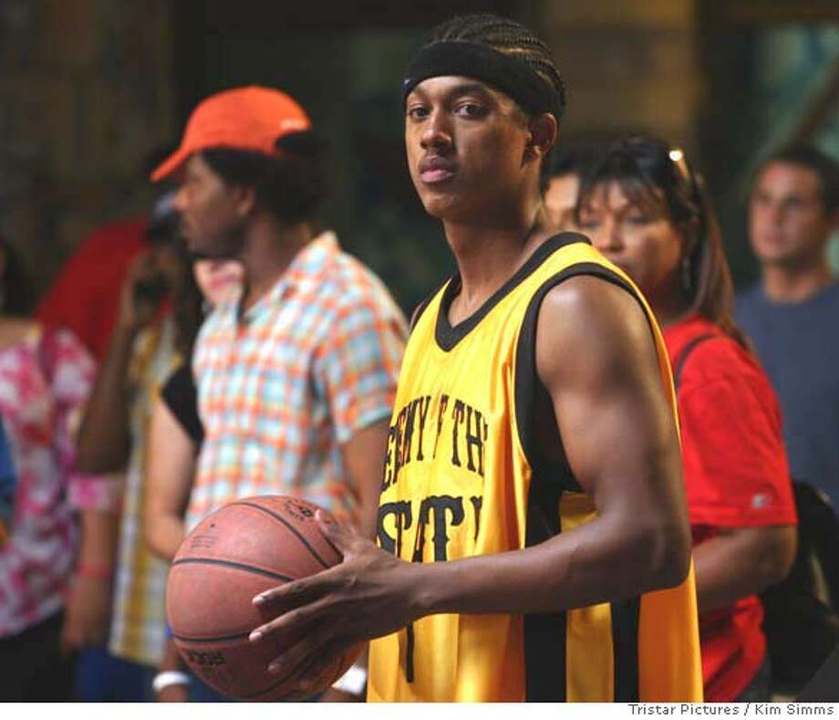 "In this photo provided byTriStar Pictures, a naturally talented basketball player, Noah Cruise (Wesley Jonathan) is determined to become a doctor using his basketball scholarship to UCLA pre-med, rather than succumb to the lure of a former sports agent and go for the NBA in ""Crossover."" (AP Photo/Tristar Pictures/Kim Simms) Photo: KIM SIMMS"