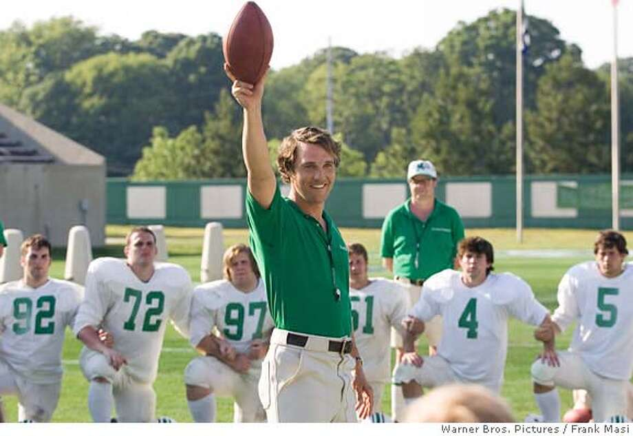 In this photo provided by Warner Bros. Pictures, Coach Jack Lengyel (MATTHEW McCONAUGHEY) holds a football aloft while giving a pep talk to the young Thundering Herd in We Are Marshall, (AP Photo/Warner Bros. Pictures/Frank Masi) Photo: Frank Masi