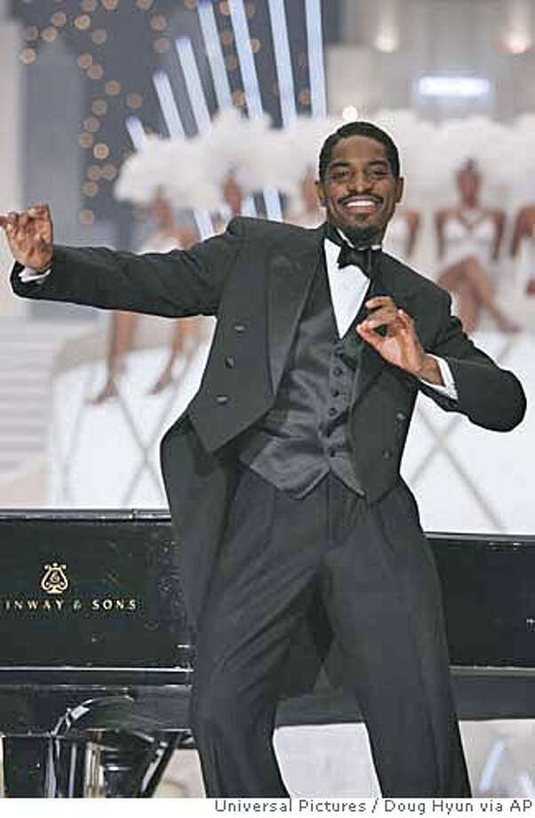 """In this photo provided by Universal Pictures, Shy piano player Percival (Andre Benjamin) breaks out of his shell on the big stage in """"Idlewild."""" (AP Photo/Universal Pictures/ Doug Hyun) Photo: DOUG HYUN"""