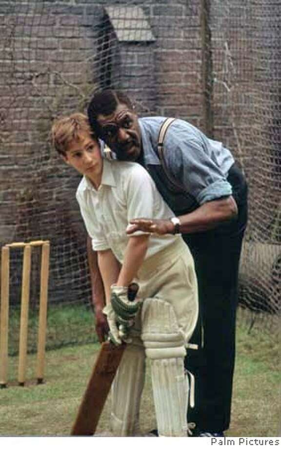 Delroy Lindo (Dennis) coaches Sam Smith (David) in WONDROUS OBLIVION, a 2006 Palm Pictures release. Photo: Palm Pictures