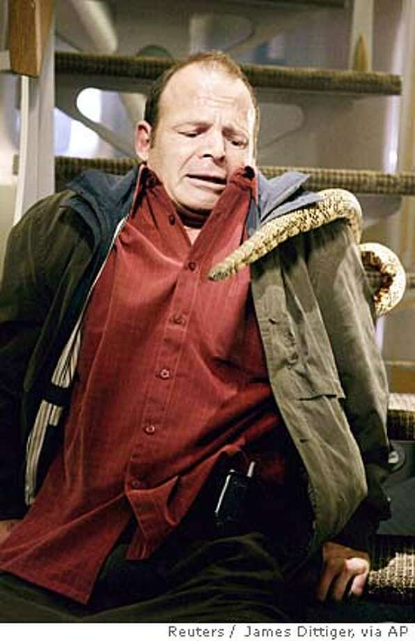 "Actor Mark Houghton is shown in a scene from the new action feature film ""Snakes On A Plane"" in this undated handout photograph. After endless parodies, Weblogs, videos, books, news reports and T-shirts, ""Snakes on a Plane"" finally opens in the United States on August 18, 2006 with no one knowing quite what to expect from the super-hyped film other than a story about reptiles patrolling a panicky passenger jet. To match feature LEISURE SNAKES. NO ARCHIVES FOR EDITORIAL USE ONLY REUTERS/James Dittiger/New Line Productions/Handout (UNITED STATES) Photo: HO"