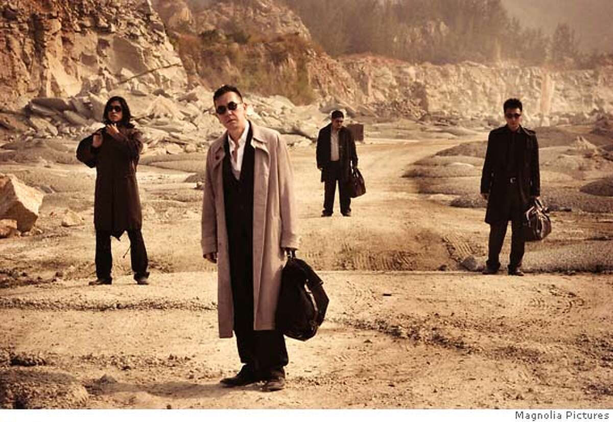 Roy Cheung, Anthony Wong, Lam Suet and Francis Ng in EXILED, a Magnolia Pictures release. Photo courtesy of Magnolia Pictures.