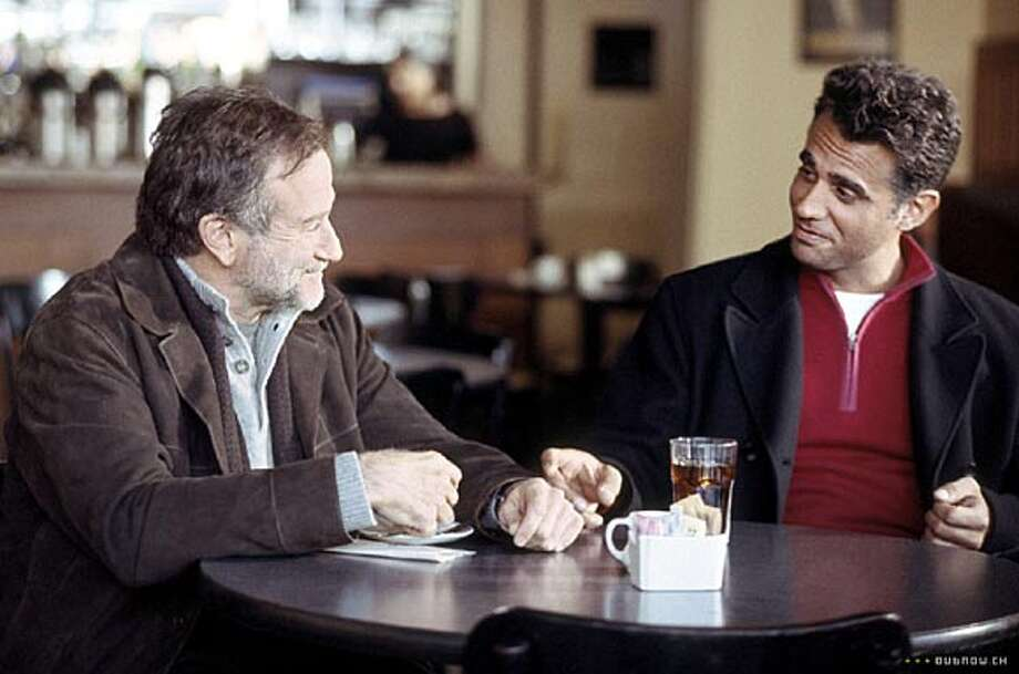 Gabriel (Robin Williams, left), a radio storyteller, is feeling vulnerable during his breakup with Jess (Bobby Cannavale). Photo courtesy of Miramax