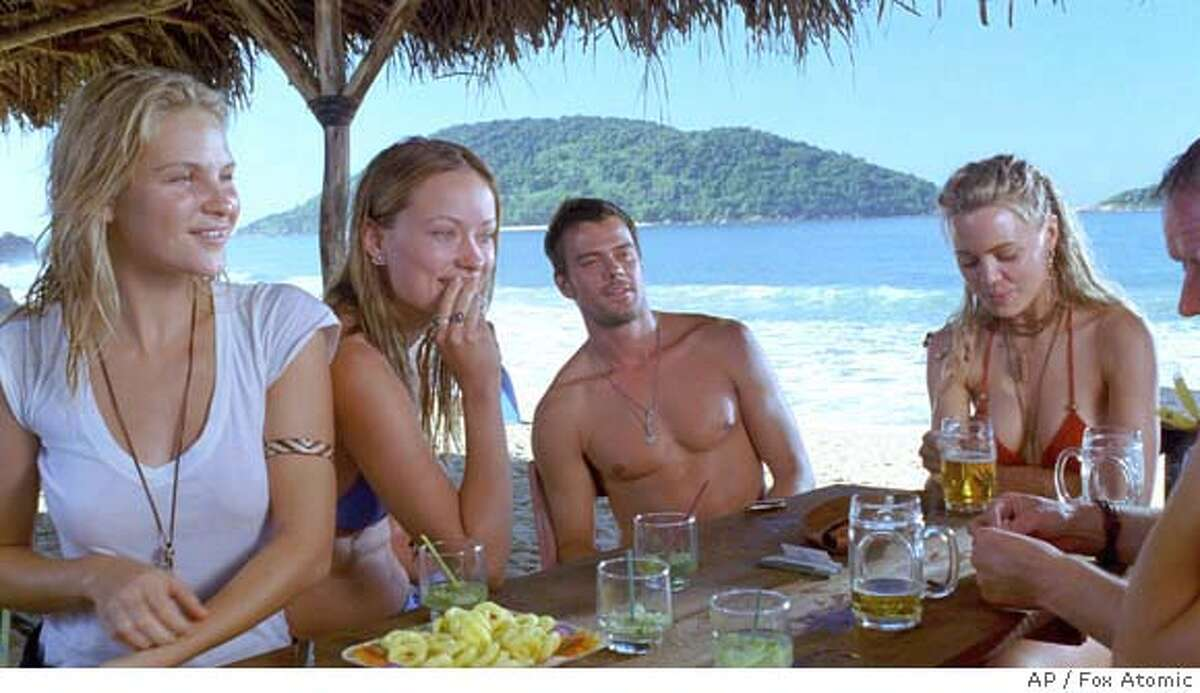 In this photo provided by Fox Atomic, after a terrifying bus accident maroons them in a remote Brazilian beach town, a group of young adventure travelers (Left to right: Beau Garrett, Olivia Wilde, Josh Duhamel, Melissa George) discover that the white sand beaches and lush jungles are concealing a darker, unsettling secret in