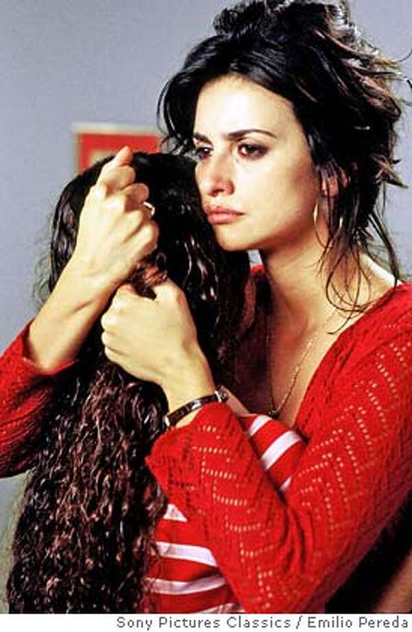 "�In this photo provided by Sony Pictures Classics, Paula (Yohana Cobo) hugs her mother Raimunda (Penelope Cruz) in ""Volver."" (AP Photo/Sony Pictures Classics/Emilio Pereda) Photo: EMILIO PEREDA"