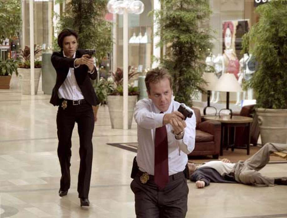 Secret Service Agents Jill Marin (Eva Longoria) and David Breckinridge (Kiefer Sutherland) pursue an assassin in The Sentinel. Photo: Doane Gregory