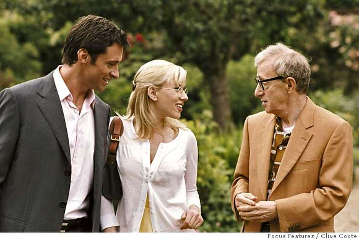 This undated photo supplied by Focus Features shows Hugh Jackman, left, Scarlett Johansson and Woody Allen, right, in a scene from Woody Allens
