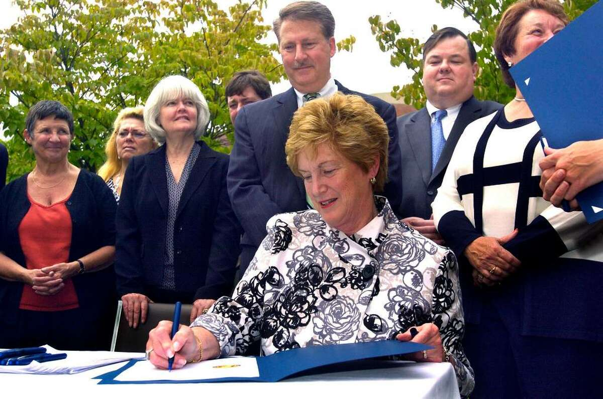 Carol Kaliff/staff photographer. Gov. M. Jodi Rell was in Brookfield Thursday to sign a bill regarding Lyme Disease. Among those with her, left to are, Andrea O'Connor, First Selectwoman in Sherman, New Milford Mayor Pat Murphy, State Representative Peggy Reeves , Senator Andrew Roraback, State Representatives David Scribner, John Frye and Jan Geigler. Photo taken July 16, 2009