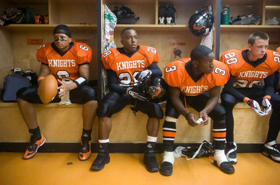 Stamford players, from left, Jalen Holmes, Anderson Boursiqout, Mark Seward and Donnacha O'Dwyer wait in the locker room for the game to start before an FCIAC football game against Ridgefield High School at Stamford High School in Stamford, Conn. on Thursday, Sept. 17, 2009 Photo: Chris Preovolos / Stamford Advocate