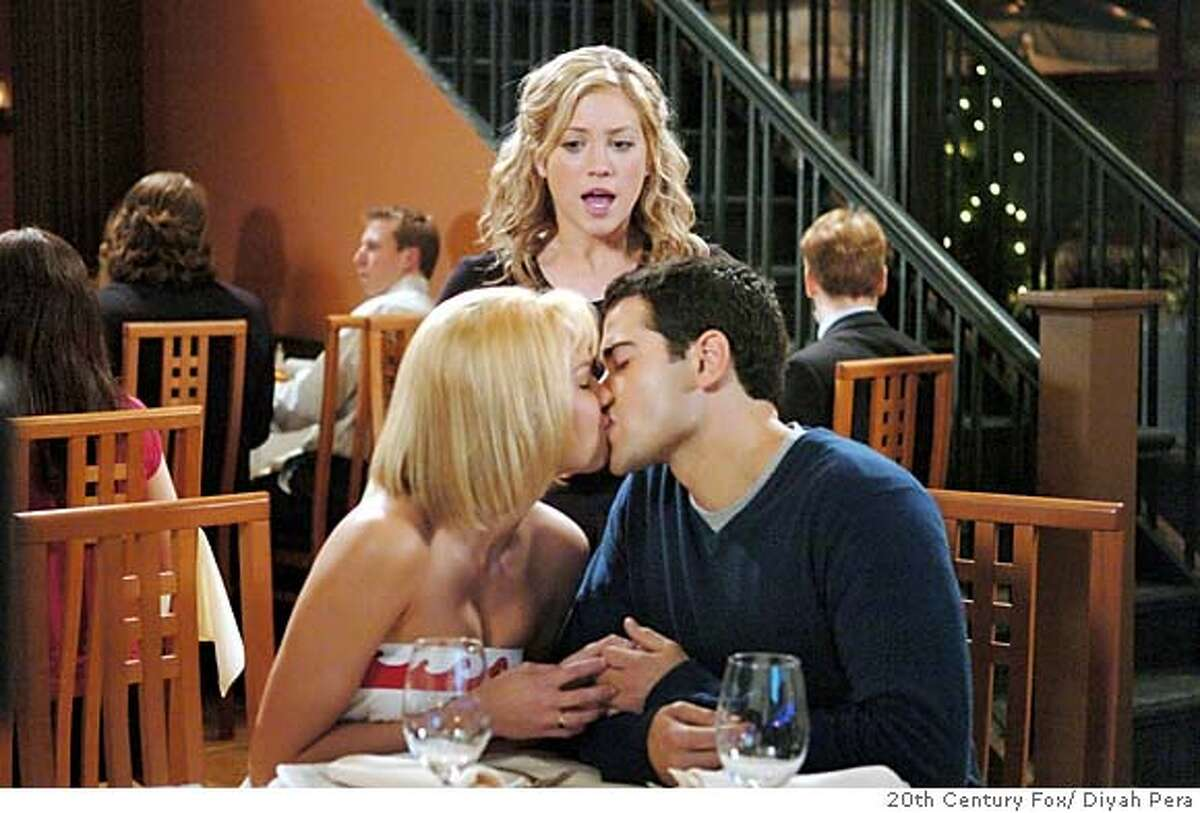 In this photo provided by 20th Century Fox, canoodling couple Carrie (Arielle Kebbel) and John Tucker (Jesse Metcalfe) are oblivious to waitress Kate (Brittany Snow) in 'John Tucker Must Die.' (AP Photo/20th Century Fox/ Diyah Pera)