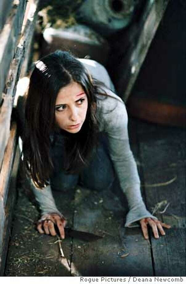USCN-046-11 - Sarah Michelle Gellar stars in Asif Kapadia's THE RETURN, a Rogue Pictures release.  Photo: Deana Newcomb Ran on: 11-13-2006  Sarah Michelle Gellar as Joanna Mills, a saleswoman whose homecoming is marked by haunting images in &quo;The Return.&quo; Photo: Photo: Deana Newcomb